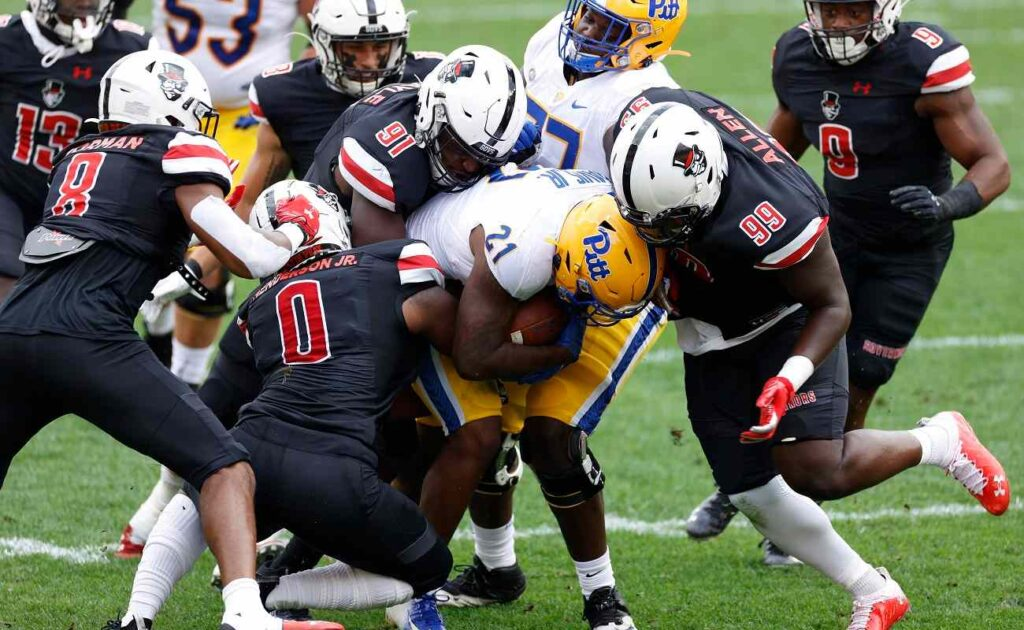 PITTSBURGH, PA - SEPTEMBER 12: Austin Peay Governors defenders combine to make a tackle during a game against the Pittsburgh Panthers at Heinz Field on September 12, 2020 in Pittsburgh, Pennsylvania. The Panthers won 55-0. (Photo by Joe Robbins/Getty Images)