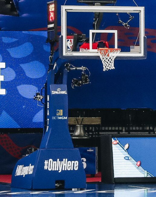 A blue basketball pole pad with the NBA, Spalding and BetMGM logos on and the hashtag #OnlyHere written on the base.