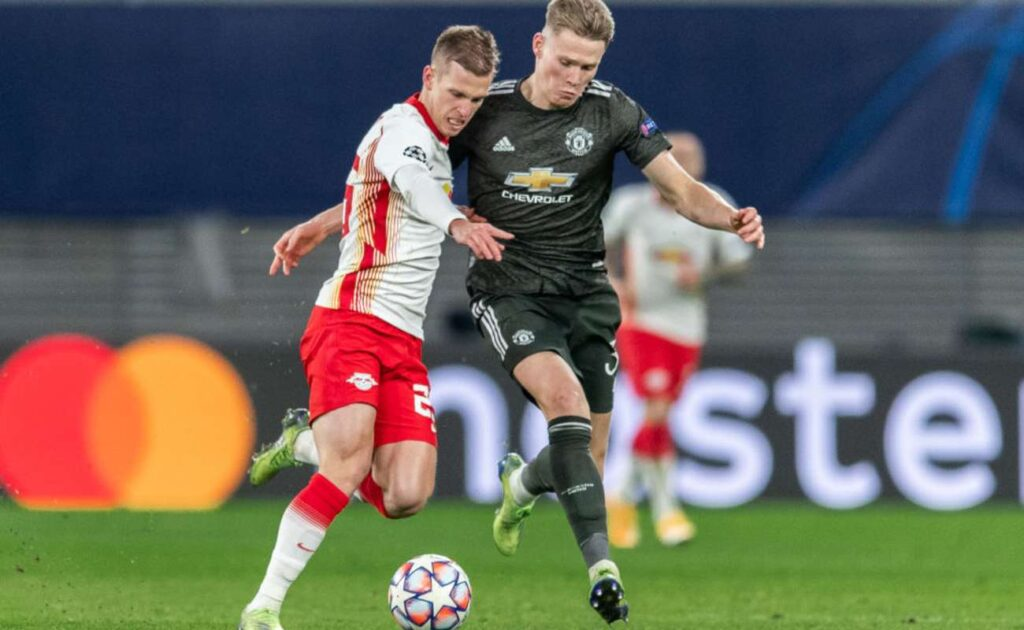 Scott McTominay of Manchester United Tackles Dani Olmo of RB Leipzig - Photo By Boris Streubel