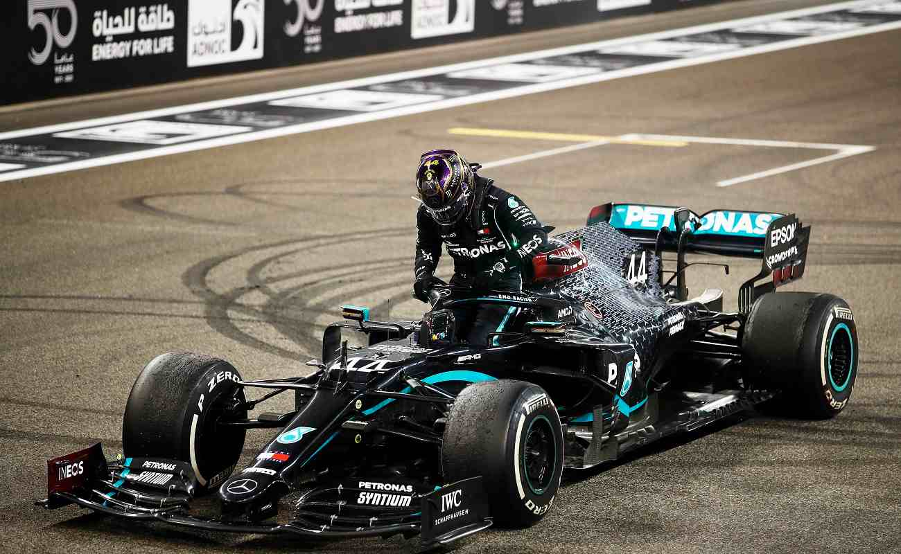 ABU DHABI, UNITED ARAB EMIRATES - DECEMBER 13: Third placed Lewis Hamilton of Great Britain and Mercedes GP climbs from his car after the F1 Grand Prix of Abu Dhabi at Yas Marina Circuit on December 13, 2020 in Abu Dhabi, United Arab Emirates. (Photo by Hamad I Mohammed - Pool/Getty Images)