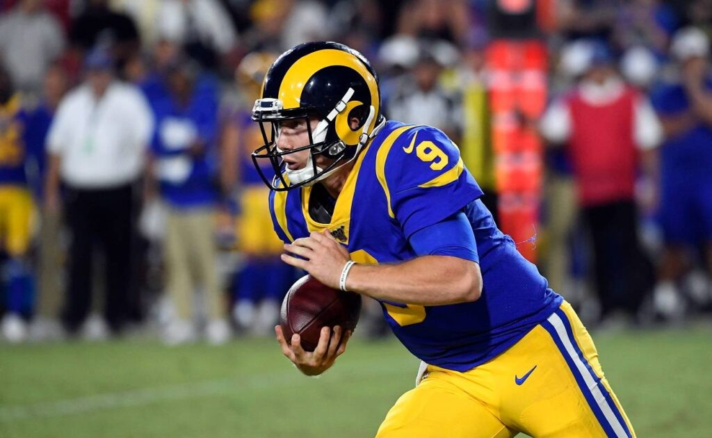 LOS ANGELES, CA - AUGUST 24: Quarterback John Wolford #9 of the Los Angeles Rams rushes against Denver Broncos during the second half of their pre season football game at Los Angeles Memorial Coliseum on August 24, 2019 in Los Angeles, California. (Photo by Kevork Djansezian/Getty Images)