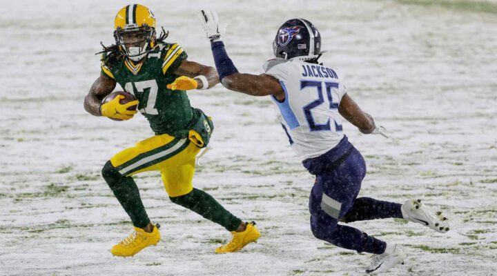 Davante Adams #17 of the Green Bay Packers runs with the ball while being chased by Adoree' Jackson #25 of the Tennessee Titans in the first quarter at Lambeau Field on December 27, 2020 in Green Bay, Wisconsin. (Photo by Dylan Buell/Getty Images)