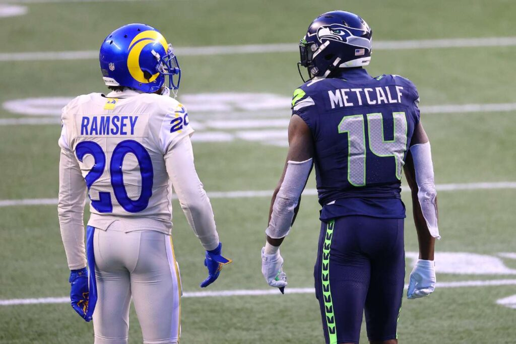 Jalen Ramsey #20 of the Los Angeles Rams and DK Metcalf #14 of the Seattle Seahawks have a conversation in the fourth quarter at Lumen Field on December 27, 2020 in Seattle, Washington. (Photo by Abbie Parr/Getty Images)