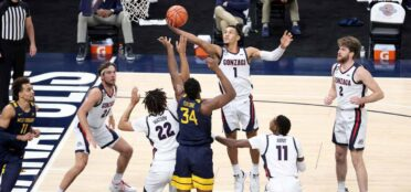 Jalen Suggs #1 of the Gonzaga Bulldogs shoots the ball against the West Virginia Mountaineers during the Jimmy V Classic at Bankers Life Fieldhouse on December 02, 2020 in Indianapolis, Indiana. (Photo by Andy Lyons/Getty Images)