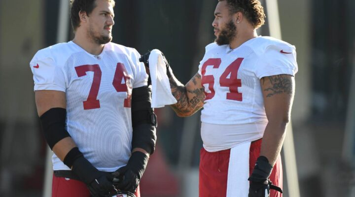 TAMPA, FLORIDA - SEPTEMBER 02: Ali Marpet #74 and Aaron Stinnie #64 of the Tampa Bay Buccaneers talk during training camp at AdventHealth Training Center on September 02, 2020 in Tampa, Florida. (Photo by Douglas P. DeFelice/Getty Images)