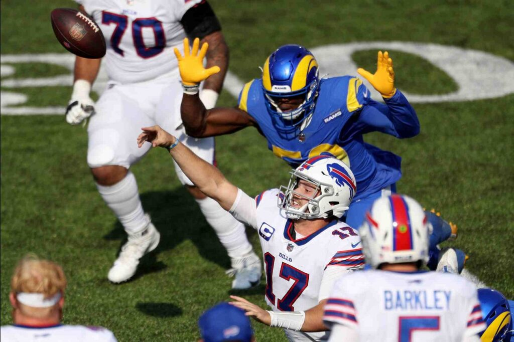 ALT: ORCHARD PARK, NEW YORK - SEPTEMBER 27: Josh Allen #17 of the Buffalo Bills is tackled while throwing the ball during the fourth quarter against the Los Angeles Rams at Bills Stadium on September 27, 2020 in Orchard Park, New York. (Photo by Bryan M. Bennett/Getty Images)