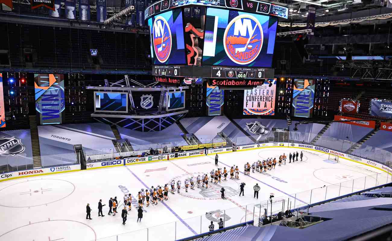 The New York Islanders and the Philadelphia Flyers shake hands before a game at the Scotiabank Arena. Photo by Elsa/Getty Images.