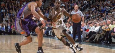 Gary Payton #20 of the Seattle SuperSonics moves with the ball against Shawnn Marion #31 of the Phoenix Suns during the game at the Key Arena in Seattle, Washington. The Suns defeated the Sonics 91-88. Photo by Otto Greule Jr /Allsport