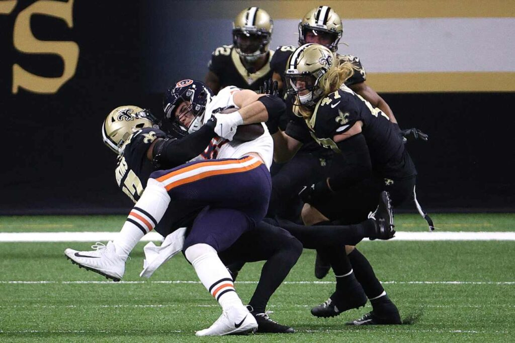 Cole Kmet #85 of the Chicago Bears is tackled by Malcolm Jenkins #27 of the New Orleans Saints during the second quarter in the NFC Wild Card Playoff game at Mercedes Benz Superdome on January 10, 2021 in New Orleans, Louisiana. (Photo by Chris Graythen/Getty Images)