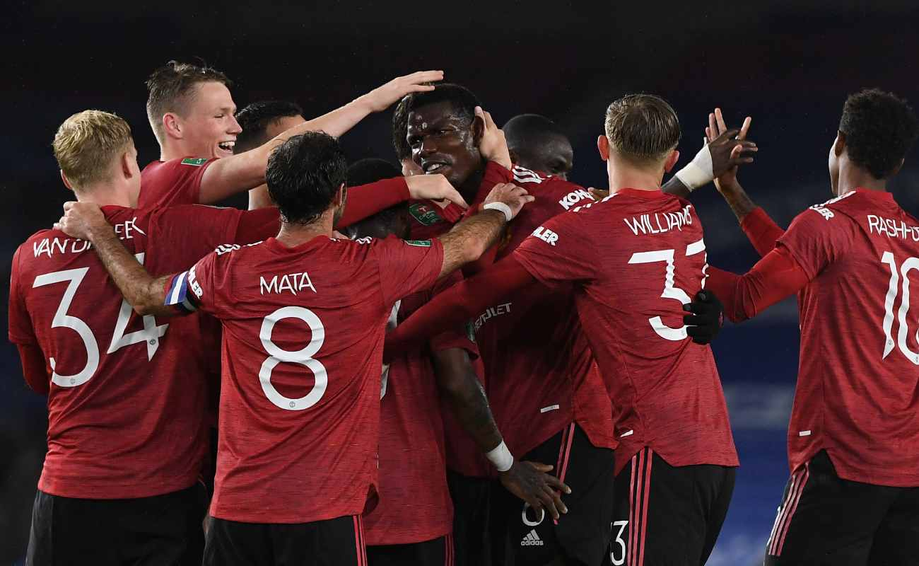 Paul Pogba is Congratulated by His Teammates After Scoring a Goal - Photo Credit: ANDY RAIN/POOL/AFP via Getty Images