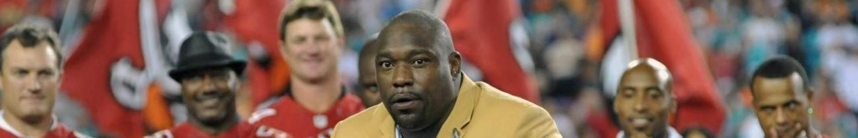 TAMPA, FL - NOVEMBER 11: NFL television commentator Warren Sapp receives his NFL Hall of Fame ring during halftime ceremonies as the Tampa Bay Buccaneers play against the Miami Dolphins November 11, 2013 at Raymond James Stadium in Tampa, Florida. Tampa won 22 - 19. (Photo by Al Messerschmidt/Getty Images)