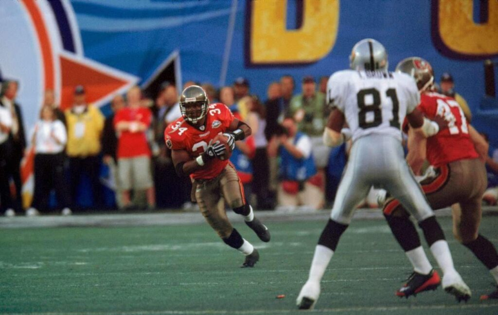 SAN DIEGO, CA - JANUARY 26: Tampa Bay Buccaneers safety Dexter Jackson intercepts a pass against the Oakland Raiders in Super Bowl XXXVII on 01/26/2003. Jackson had 2 of his team's 5 interceptions and was named the most valuable player of Tampa Bay's 48 to 21 victory. (Photo by Michael Zagaris/Getty Images)