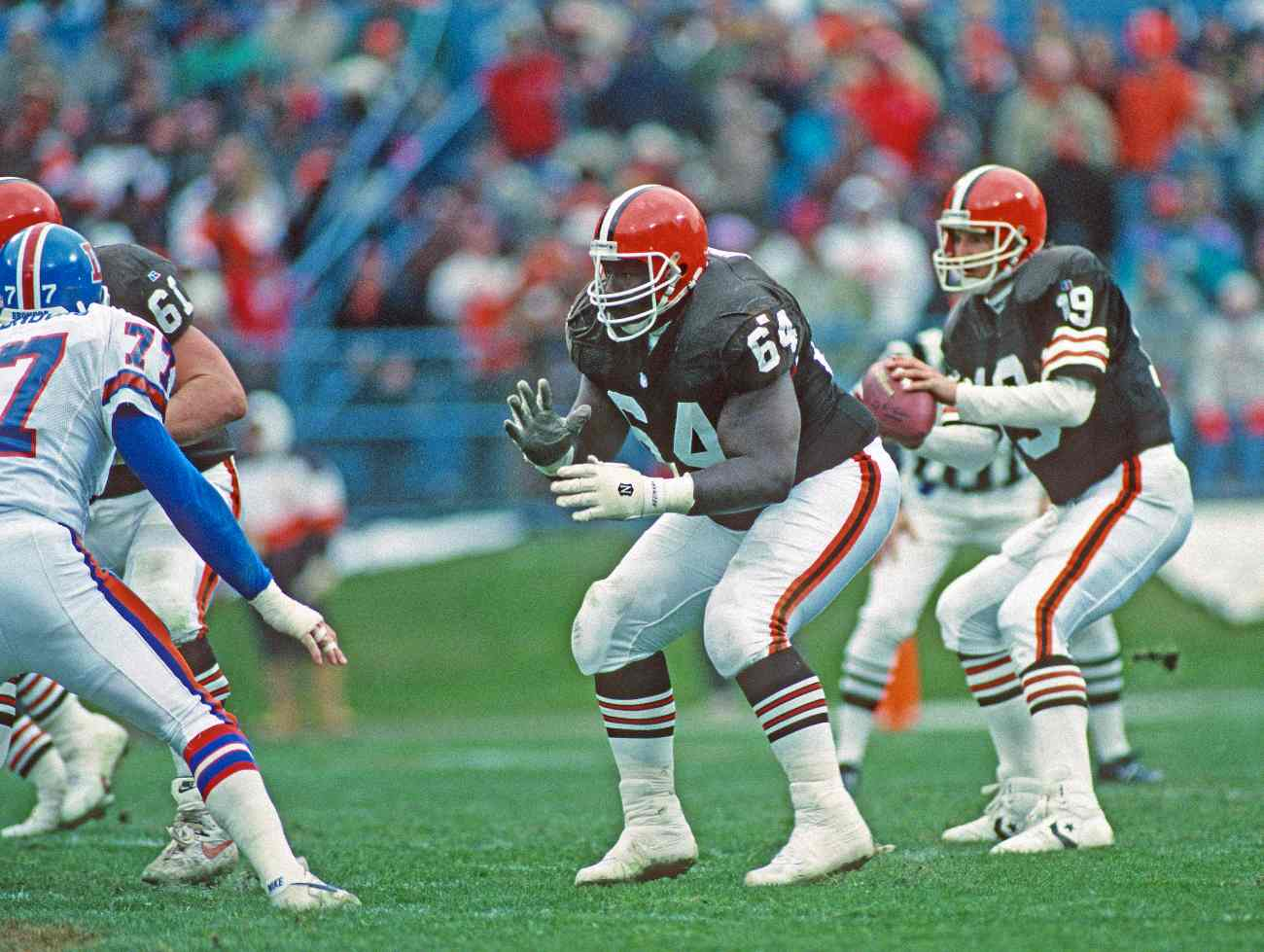 CLEVELAND, OH - NOVEMBER 7: Offensive lineman Houston Hoover #64 of the Cleveland Browns blocks as quarterback Bernie Kosar #19 looks to pass during a game against the Denver Broncos at Cleveland Municipal Stadium on November 7, 1993 in Cleveland, Ohio. The Broncos defeated the Browns 29-14. (Photo by George Gojkovich/Getty Images)