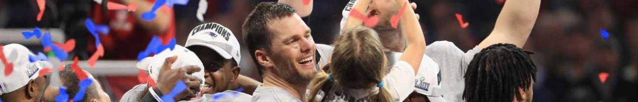 """Tom Brady #12 of the New England Patriots celebrates with daughter """"Vivian,"""" who raises the Vince Lombardi Trophy after Super Bowl LIII at Mercedes-Benz Stadium on February 3, 2019, in Atlanta, Georgia. The New England Patriots defeat the Los Angeles Rams 13-3. (Photo by Mike Ehrmann/Getty Images)"""