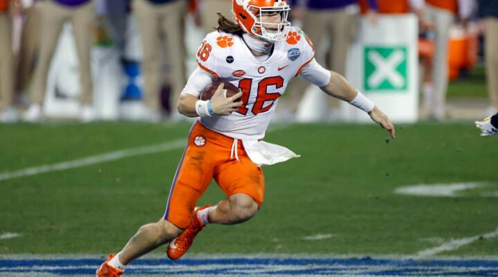 CHARLOTTE, NORTH CAROLINA - DECEMBER 19: Quarterback Trevor Lawrence #16 of the Clemson Tigers runs with the ball in the fourth quarter against the Notre Dame Fighting Irish during the ACC Championship game at Bank of America Stadium on December 19, 2020 in Charlotte, North Carolina. (Photo by Jared C. Tilton/Getty Images)
