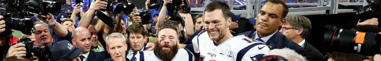 Tom Brady #12 of the New England Patriots and Julian Edelman #11 of the New England Patriots celebrate after Super Bowl LIII at Mercedes-Benz Stadium on February 03, 2019, in Atlanta, Georgia. (Photo by Maddie Meyer/Getty Images)