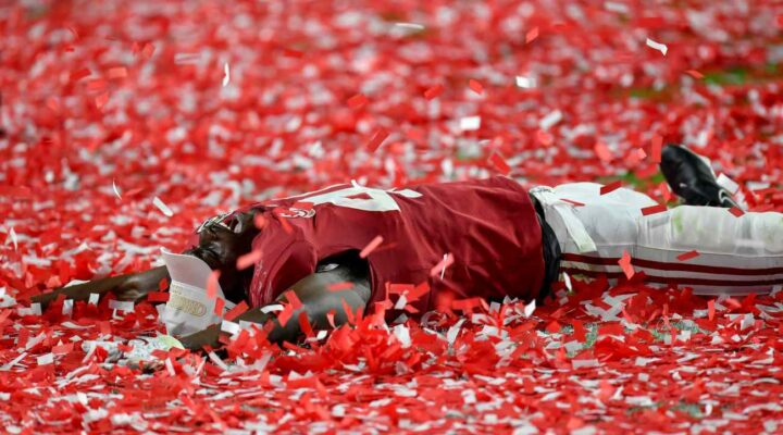 MIAMI GARDENS, FLORIDA - JANUARY 11: Joshua McMillon #40 of the Alabama Crimson Tide makes confetti angels after the College Football Playoff National Championship football game against the Ohio State Buckeyes at Hard Rock Stadium on January 11, 2021 in Miami Gardens, Florida. The Alabama Crimson Tide defeated the Ohio State Buckeyes 52-24. (Photo by Alika Jenner/Getty Images)