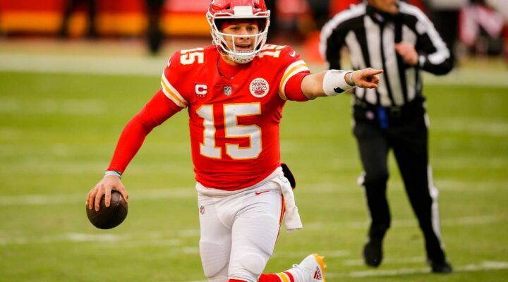 Patrick Mahomes #15 of the Kansas City Chiefs looks for an open receiver in the second quarter against the Cleveland Browns in the AFC Divisional Playoff at Arrowhead Stadium on January 17, 2021, in Kansas City, Missouri. (Photo by David Eulitt/Getty Images)