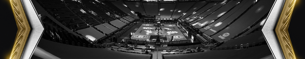 Black and white picture of an empty basketball court