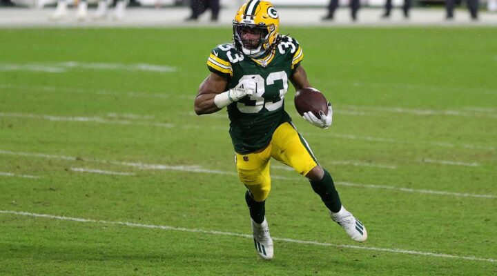 Aaron Jones #33 of the Green Bay Packers runs for yards during the NFC Divisional Playoff game against the Los Angeles Rams at Lambeau Field on January 16, 2021 in Green Bay, Wisconsin. The Packers defeated the Rams 32-18. (Photo by Stacy Revere/Getty Images)