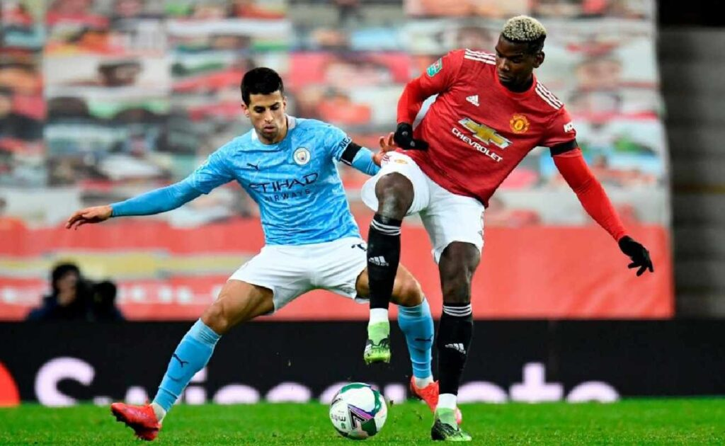 Paul Pogba of Manchester United Battles it Out With Joao Cancelo of Manchester City - Photo by: PETER POWELL/POOL/AFP via Getty Images