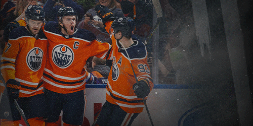 Oscar Klefbom #77, Connor McDavid #97 and Ryan Nugent-Hopkins #93 of the Edmonton Oilers celebrate McDavids goal against the Montreal Canadiens at Rogers Place on December 21, 2019, in Edmonton, Canada.