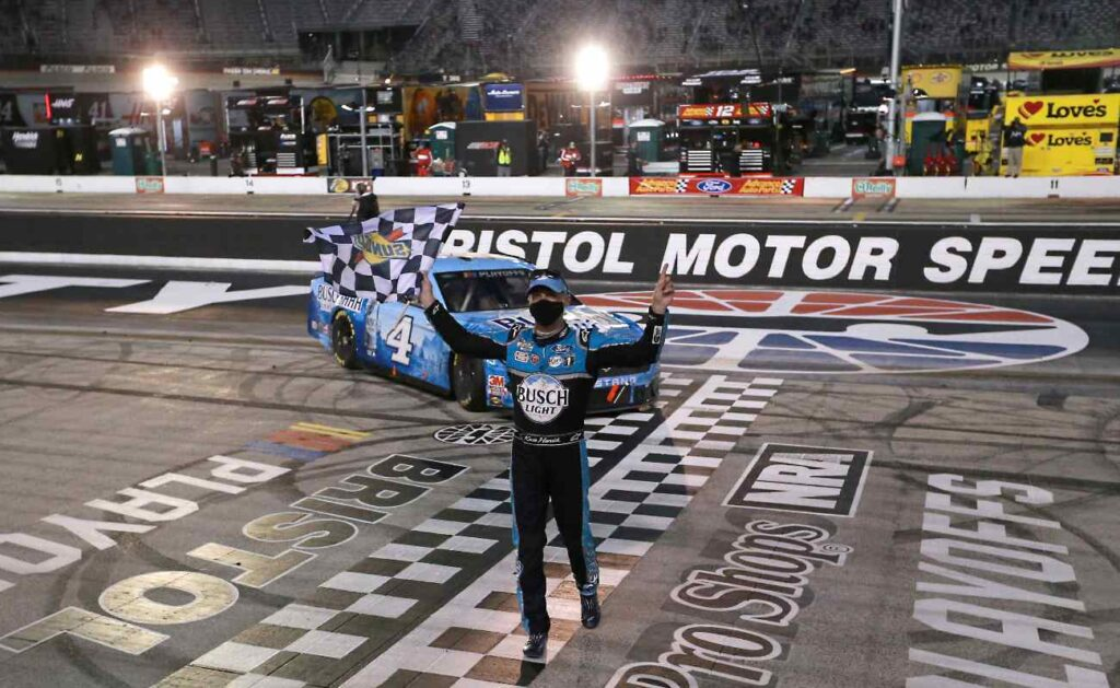 BRISTOL, TENNESSEE - SEPTEMBER 19: Kevin Harvick, driver of the #4 Busch Light Ford, celebrates after winning the NASCAR Cup Series Bass Pro Shops Night Race at Bristol Motor Speedway on September 19, 2020 in Bristol, Tennessee. (Photo by Sean Gardner/Getty Images)