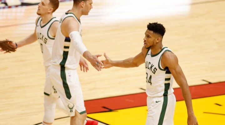 Giannis Antetokounmpo #34 of the Milwaukee Bucks high fives Brook Lopez #11 against the Miami Heat during the first quarter at American Airlines Arena on December 29, 2020, in Miami, Florida. (Photo by Michael Reaves/Getty Images)