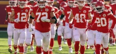 Offensive tackle Eric Fisher #72 of the Kansas City Chiefs leads players onto the field prior to the game against the Atlanta Falcons at Arrowhead Stadium on December 27, 2020 in Kansas City, Missouri. (Photo by Jamie Squire/Getty Images