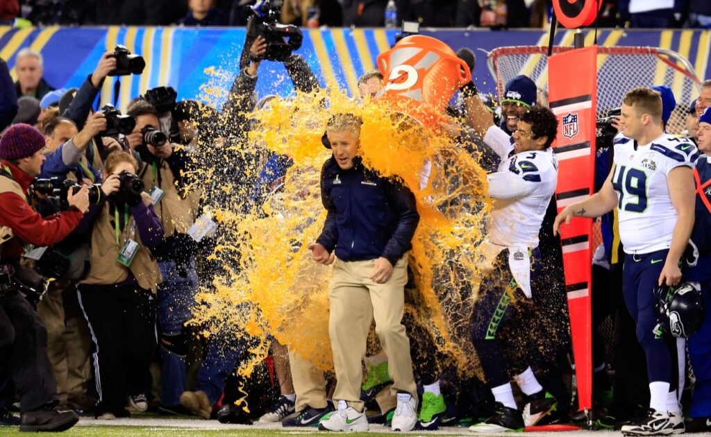 FEBRUARY 02: Tight end Zach Miller #86 and quarterback Russell Wilson #3 of the Seattle Seahawks dump Gatorade on head coach Pete Carroll in the fourth quarter of Super Bowl XLVIII against the Denver Broncos at MetLife Stadium on February 2, 2014 in East Rutherford, New Jersey. The Seattle Seahawks won 43-8. (Photo by Rob Carr/Getty Images)