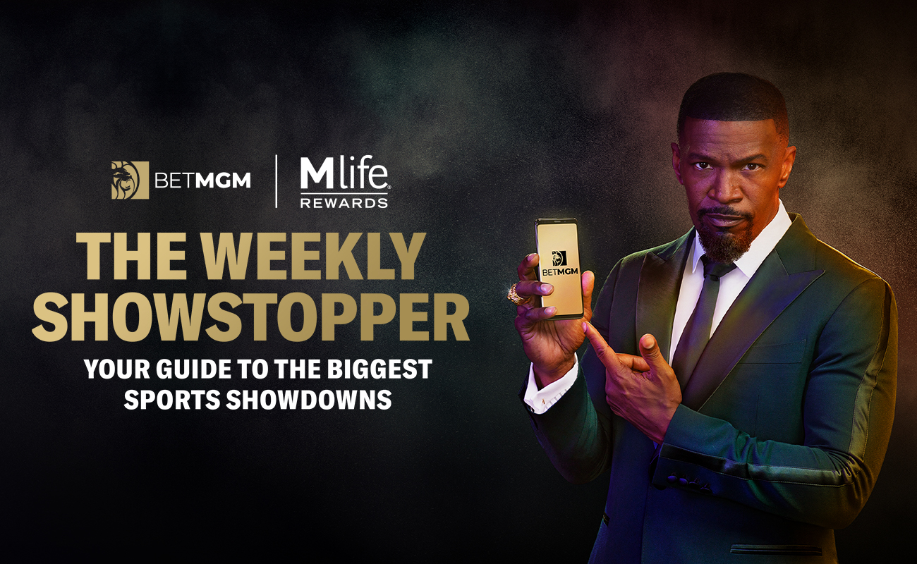 Actor and BetMGM Brand Ambassador Jamie Foxx with a phone in his right hand on a dark background