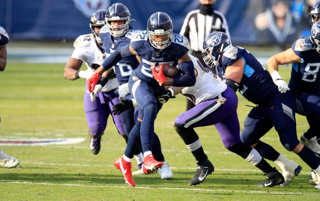 Derrick Henry #22 of the Tennessee Titans runs with the ball against the Baltimore Ravens in the Wild Card Round of the NFL Playoffs at Nissan Stadium on January 10, 2021, in Nashville, Tennessee. (Photo by Andy Lyons/Getty Images)
