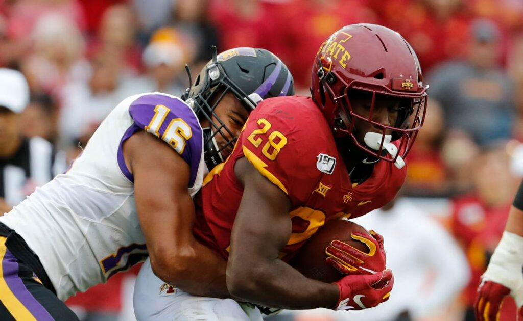 AMES, IA - AUGUST 31: Defensive lineman Elerson Smith #16 of the Northern Iowa Panthers tackles running back Breece Hall #28 of the Iowa State Cyclones as he rushed for yards in the second half of play at Jack Trice Stadium on August 31, 2019 in Ames, Iowa. The Iowa State Cyclones won 29-26 over the Northern Iowa Panthers in triple overtime. (Photo by David Purdy/Getty Images)