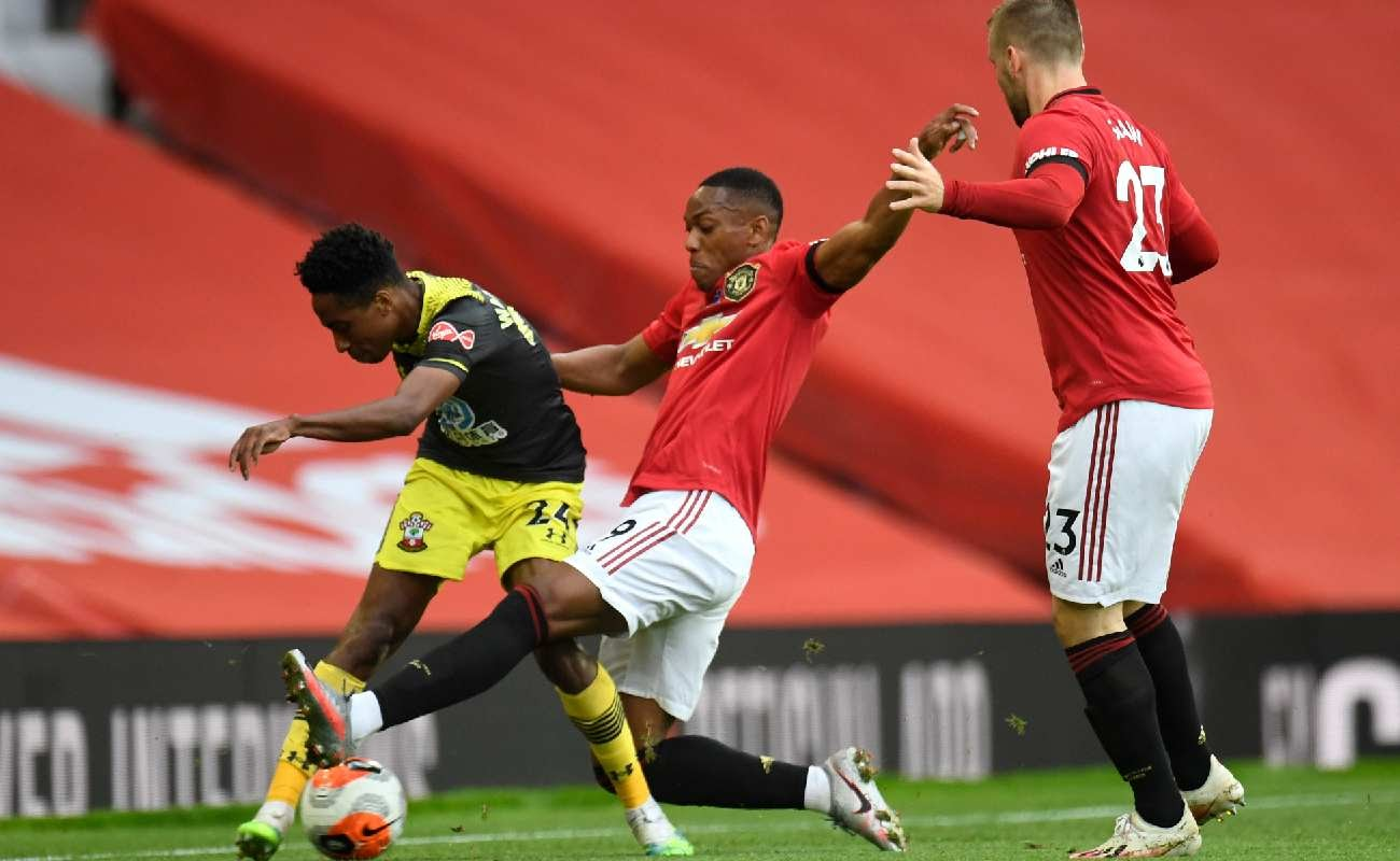 Martial and Shaw of Manchester United try get the ball from Southampton's Walker-Peters - Photo by Peter Powell/Pool via Getty Images