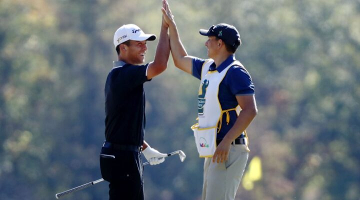 Xander Schauffele celebrates with his caddie after holing in on the second hole during the Final Round of the Sanderson Farms Championship at the Country Club of Jackson on October 30, 2016 in Jackson, Mississippi. (Photo by Sam Greenwood/Getty Images)