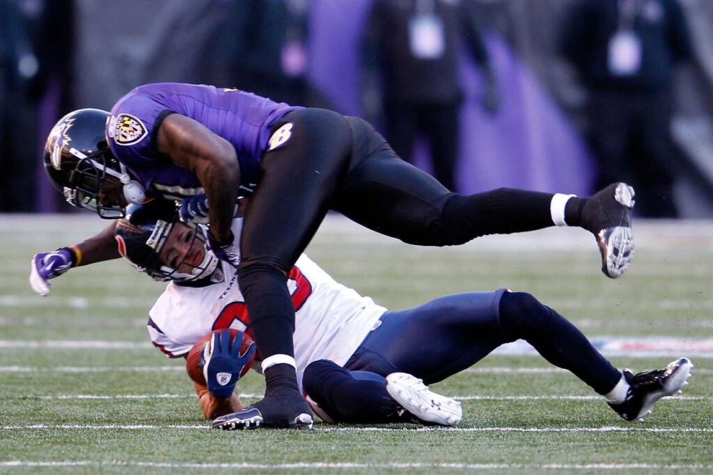 BALTIMORE, MD - JANUARY 15: Connor Barwin #98 of the Houston Texans is tackled by Bernard Pollard #31 of the Baltimore Ravens during the AFC Divisional playoff game at M&T Bank Stadium on January 15, 2012 in Baltimore, Maryland. Baltimore won 20-13 in regulation. (Photo by Rob Carr/Getty Images)