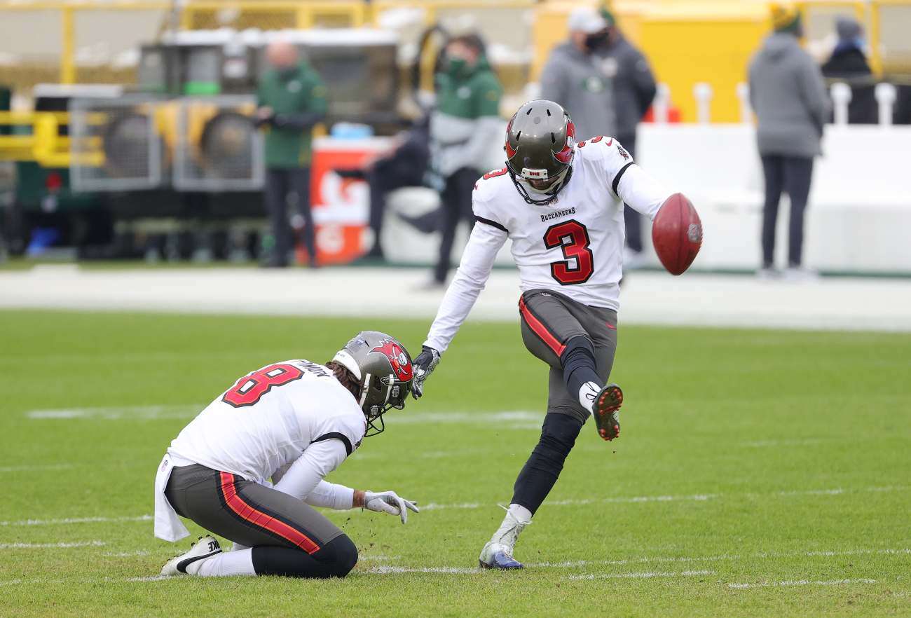 GREEN BAY, WISCONSIN - JANUARY 24: Ryan Succop #3 of the Tampa Bay Buccaneers kicks during warm ups prior to their NFC Championship game against the Green Bay Packers at Lambeau Field on January 24, 2021 in Green Bay, Wisconsin. (Photo by Stacy Revere/Getty Images)