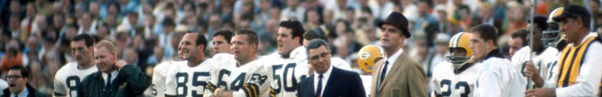MIAMI, FL - January 14: Head Coach Vince Lombardi (dark Jacket) of the Green Bay Packers looks on from the sidelines against the Oakland Raiders during Super Bowl II January 14, 1968 at the Orange Bowl in Miami, Florida. The Packers won the game 33-14. (Photo by Focus on Sport/Getty Images)