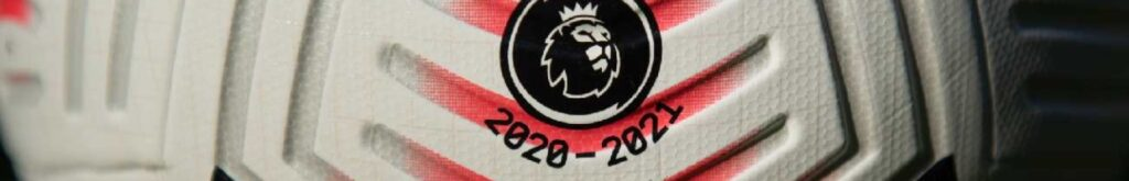 Premier League logo and season dates on a matchday ball - Photo by Visionhaus/Getty Images
