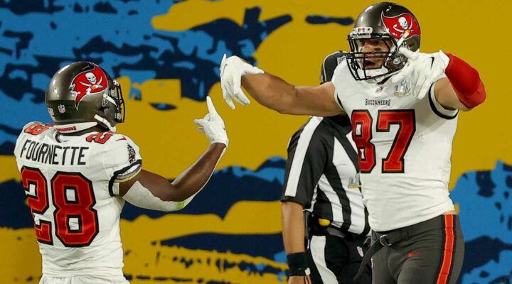 Rob Gronkowski #87 of the Tampa Bay Buccaneers celebrates after an 8 yard touchdown with Leonard Fournette #28 in the first quarter against the Kansas City Chiefs in Super Bowl LV at Raymond James Stadium on February 07, 2021 in Tampa, Florida. (Photo by Kevin C. Cox/Getty Images)