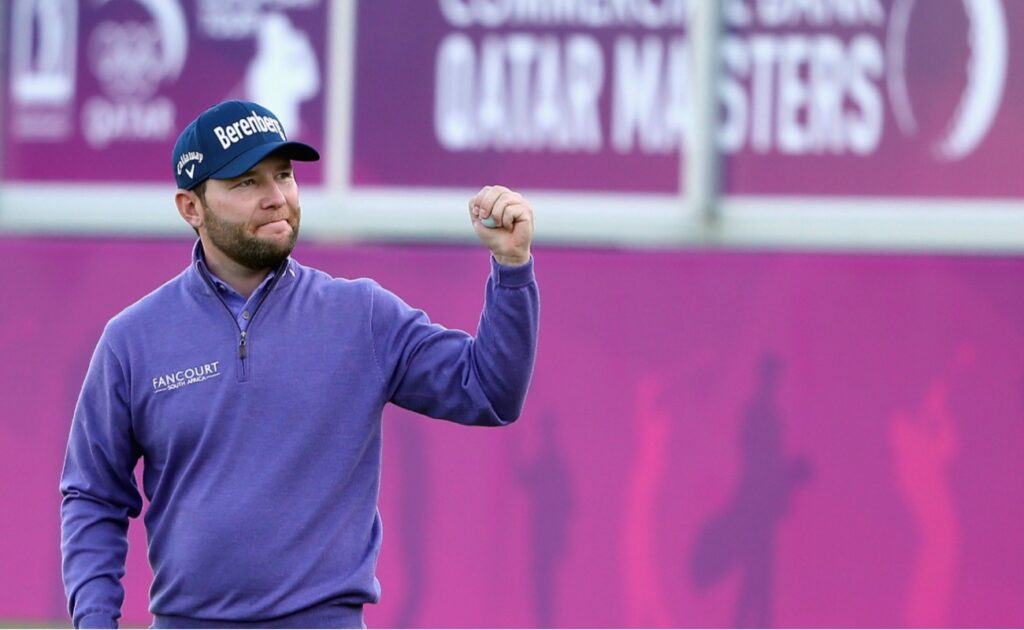 Branden Grace of South Africa celebrates on the 18th green after winning the Commercial Bank Qatar Masters at Doha Golf Club on January 30, 2016 in Doha, Qatar. (Photo by Andrew Redington/Getty Images)