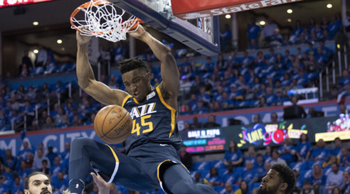 Donovan Mitchell #45 of the Utah Jazz dunks against the Oklahoma City Thunder during the first half of Game 1 of the Western Conference playoffs at the Chesapeake Energy Arena on April 15, 2018 in Oklahoma City, Oklahoma. NOTE TO USER: User expressly acknowledges and agrees that, by downloading and or using this photograph, User is consenting to the terms and conditions of the Getty Images License Agreement. (Photo by J Pat Carter/Getty Images)