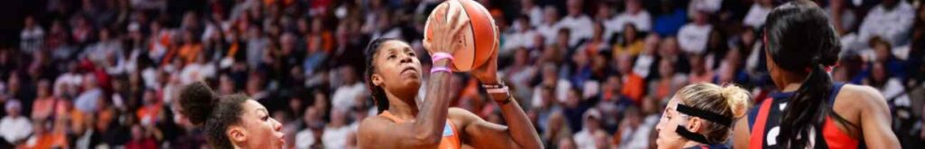 UNCASVILLE, CT - OCTOBER 6: Bria Holmes #32 of the Connecticut Sun drives past Aerial Powers #23 and Elena Delle Donne #11 of the Washington Mystics in the fourth quarter of Game 3 of the WNBA Finals at Mohegan Sun Arena on October 6, 2019 in Uncasville, Connecticut. (Photo by Kathryn Riley/Getty Images)