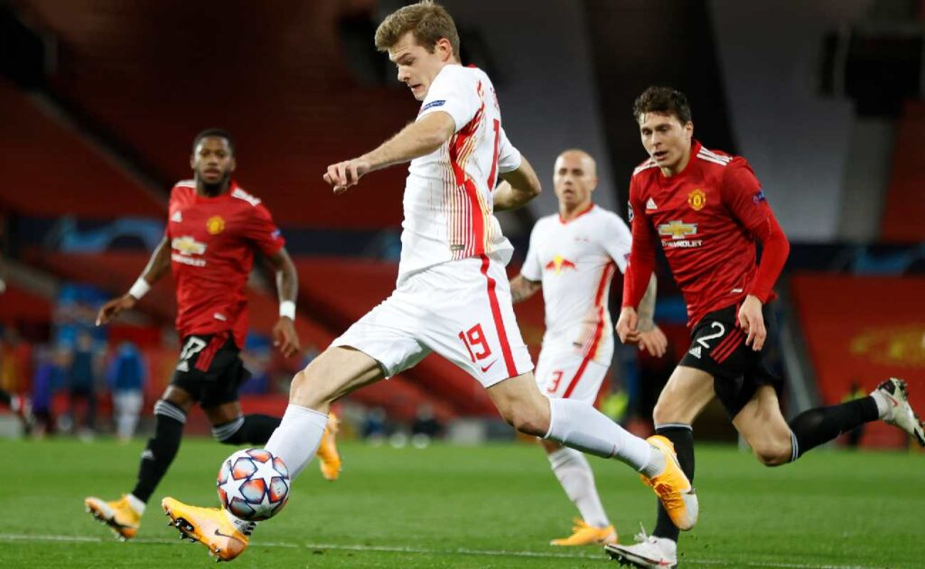 Alexander Sørloth of RB Leipzig runs with the ball in the group game against Manchester United – photo by Clive Brunskill/Getty Images.