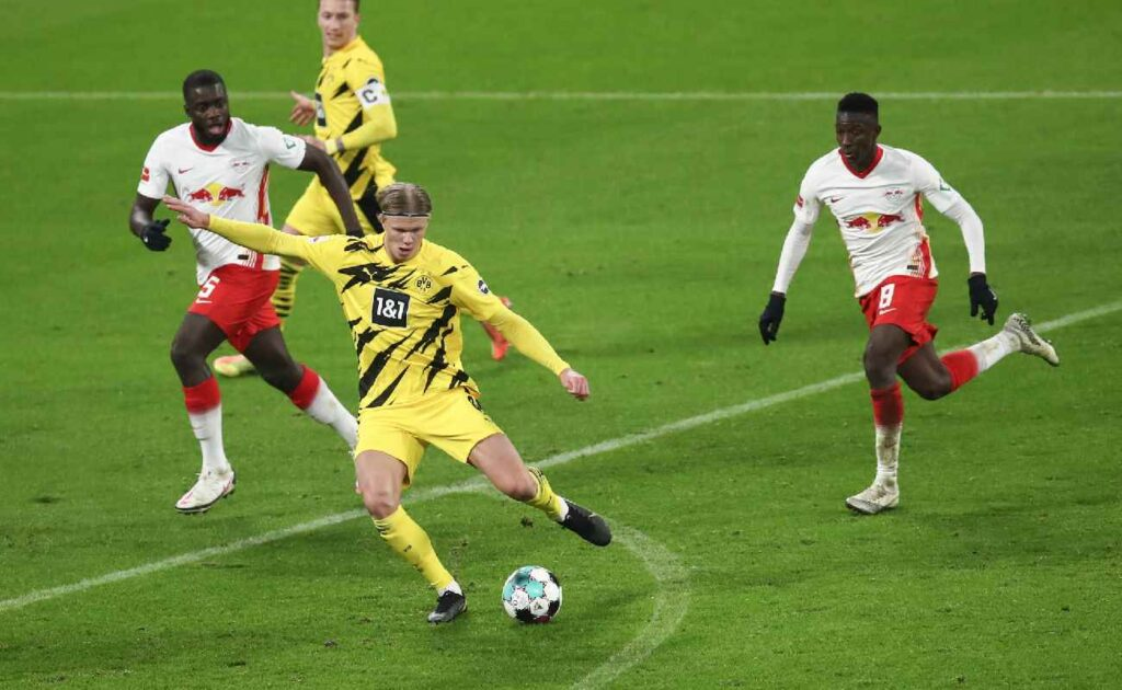 Erling Haaland takes a shot on goal in a game against RB Leipzig – photo by Maja Hitij/Getty Images.