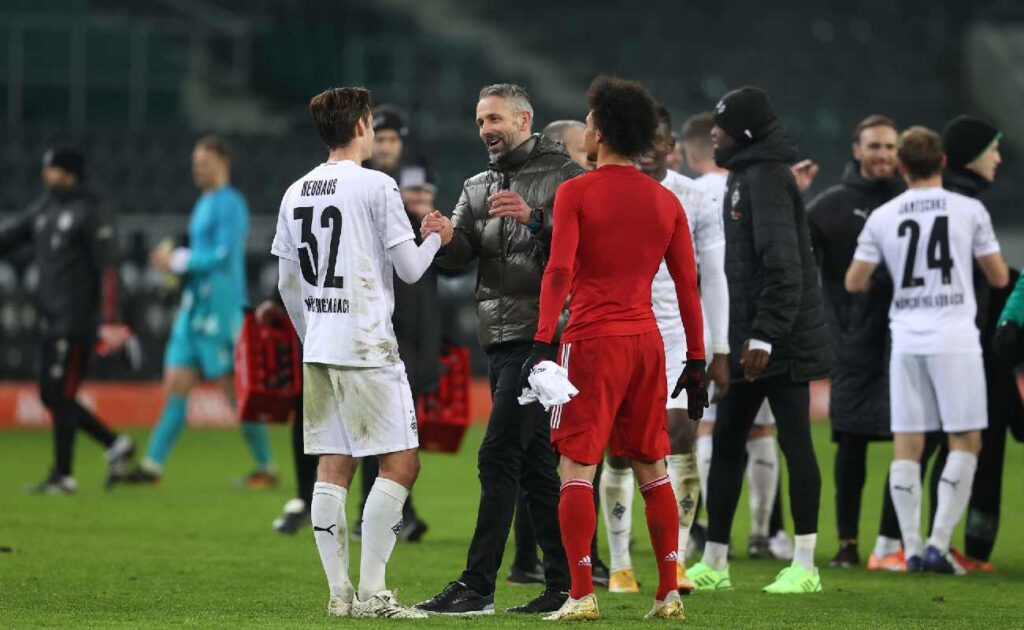 Borussia Mönchengladbach manager Marco Rose celebrates with Florian Neuhaus after their win over Bayern in January 2021 – photo by Lars Baron/Getty Images.
