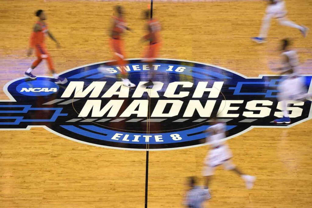 OMAHA, NE - MARCH 23: Players run across the March Madness logo during the game between the Clemson Tigers and the Kansas Jayhawks during the 2018 NCAA Men's Basketball Tournament Midwest Regional at CenturyLink Center on March 23, 2018 in Omaha, Nebraska. (Photo by Lance King/Getty Images)