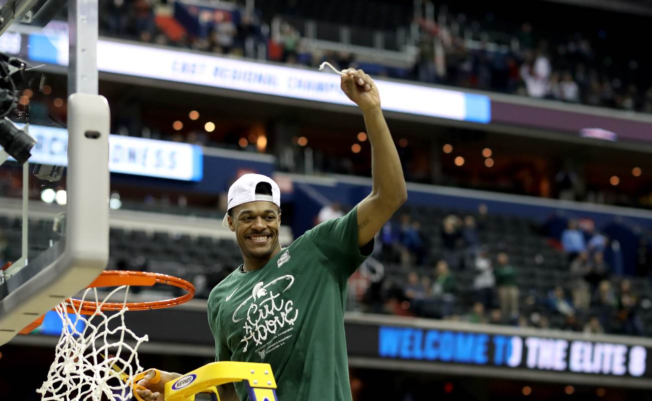 WASHINGTON, DC - MARCH 31: Xavier Tillman #23 of the Michigan State Spartans celebrate by cutting down the net after defeating the Duke Blue Devils in the East Regional game of the 2019 NCAA Men's Basketball Tournament at Capital One Arena on March 31, 2019 in Washington, DC. The Michigan State Spartans defeated the Duke Blue Devils with a score of 68 to 67. (Photo by Rob Carr/Getty Images)