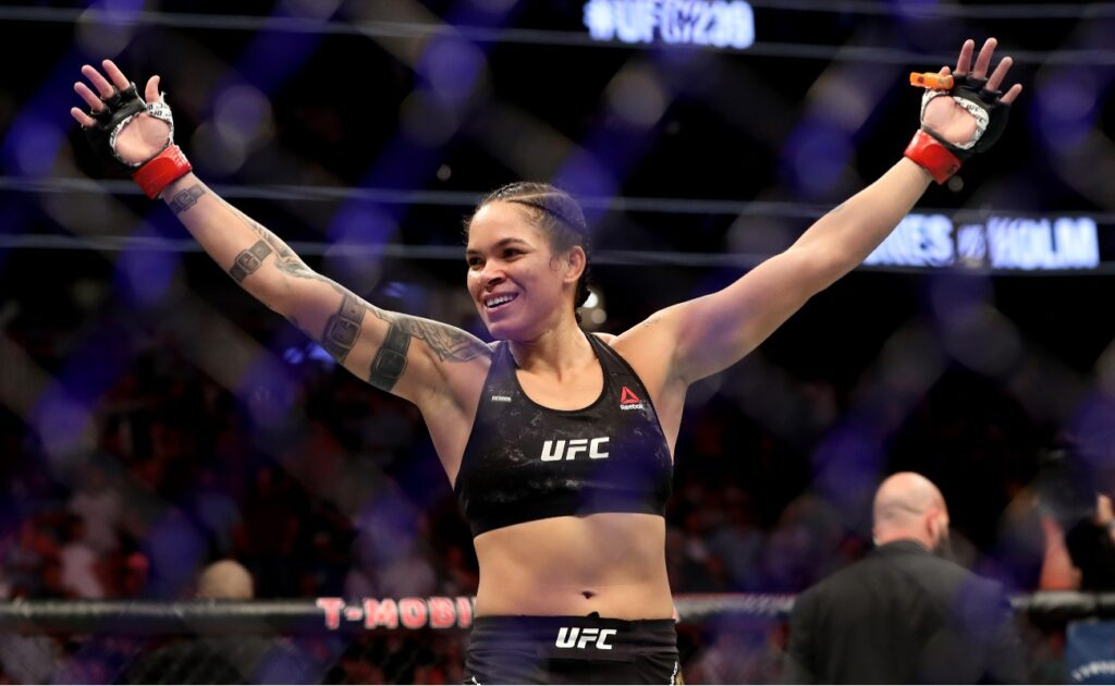 Amanda Nunes of Brazil reacts after defeating Holly Holm of the United States during their UFC Women's Bantamweight Title bout at T-Mobile Arena on July 06, 2019 in Las Vegas, Nevada. (Photo by Sean M. Haffey/Getty Images)