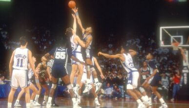LANDOVER, MD - DECEMBER 05: Alonzo Mourning #33 of the Georgetown Hoyas and Christian Laettner of the Duke Blue Devils tips off the ball during ACC/Big Eat Challenge game at USAir Arena on December 4, 1990 in Landover, Maryland (Photo by Mitchell Layton/Getty Images)